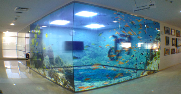 Gloss clear vinyl printed and applied to interior glass windows. The transluscent effect in this design makes the fish tank design really come to life.