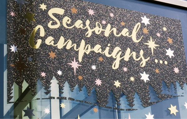 K75150 Black Glitter used as a cut-graphic background for a Seasonal window sign advert - the glistenining effect of this black vinyl is really punchy especially as the sun hits it and it sprakles, really bringing the window sign to life!
