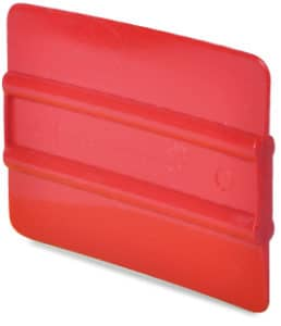 4 inch bright red ribbed soft plastic squeegee with Mactac branding subtley embossed in the middle between the two central ribs.
